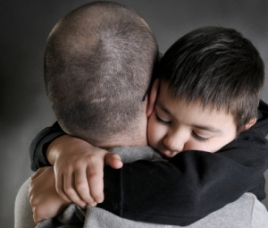 crop_of_shutterstock-dad_hugging_kid